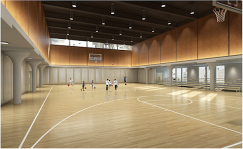The gym on the top floor of Avenues' building provides opportunities for both formal and informal athletic activities. A bleacher area also allows for spectators.