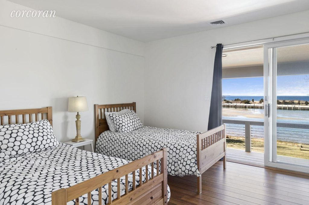 Guest Bedroom with waterside deck